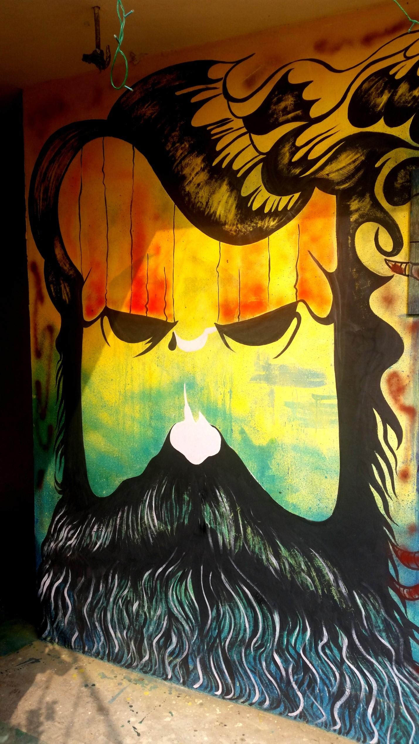 Рисунок мужчины на стене