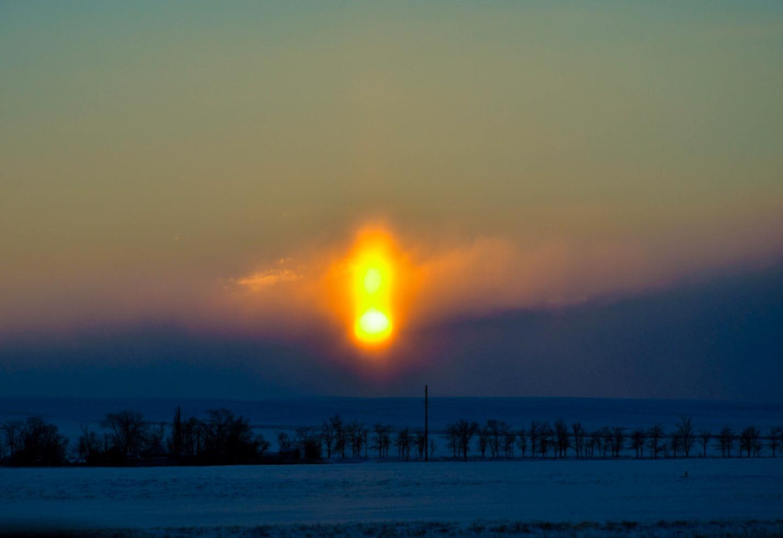 Размазанное по небу солнце
