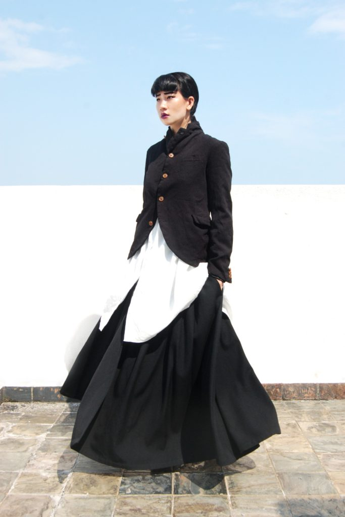 Comme des Garçons boiled polyester jacket; Yohji Yamamoto wool gabardine skirt